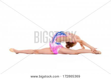 Young gymnast girl doing the splits. Professional sports. Isolated over white. Copy space.