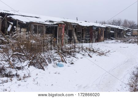 Row of old neglected barns where poor people in Ukraine saved their stuff