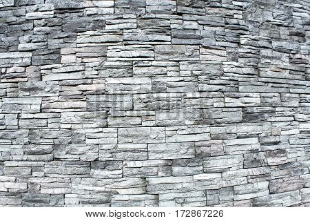 Oval stone wall texture as a background