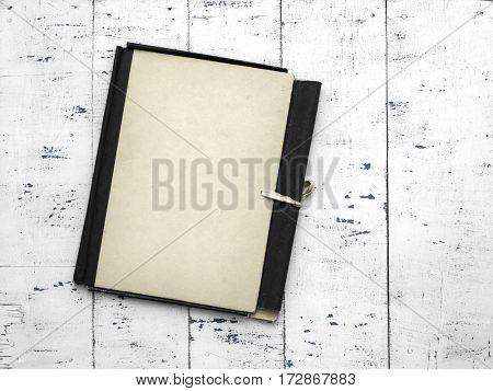retro folder on old white wooden background