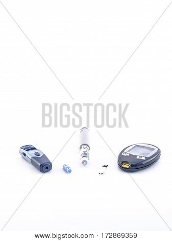 syringe pen, glucometer and testing stripe, insulin pen and needle