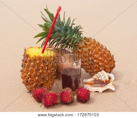 Fresh pineapple coconut rambutan and cold juice on the sunny beach.