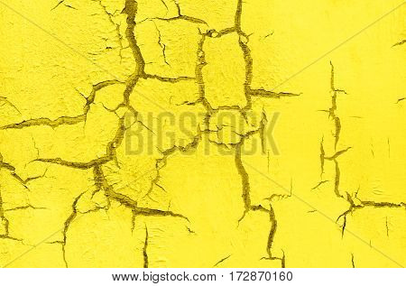 Old Damaged Cracked Paint Wall, Grunge Background, yellow color, horizontal
