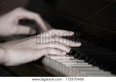 Playing the piano for a musical performance with gifted hands