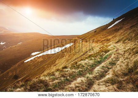 Gloomy view of the snow range under overcast sky. Dramatic scene and picturesque picture. Location place Carpathian, Ukraine, Europe. Beauty world. Retro and vintage style. Instagram toning effect.