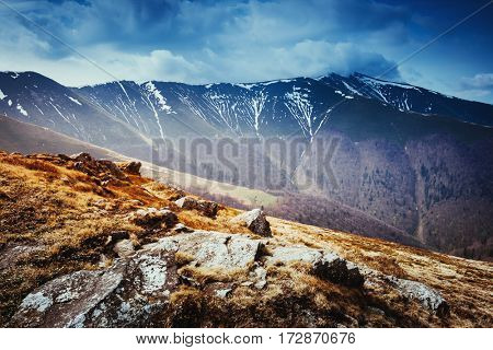 Gloomy view of the snow range under overcast sky. Dramatic scene and picturesque picture. Location place Carpathian, Ukraine, Europe. Discover the world of beauty. Instagram toning effect.