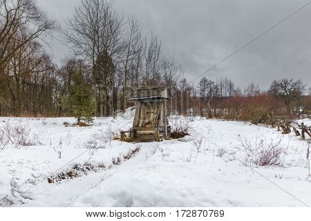 village water well in the winter in the wild place.