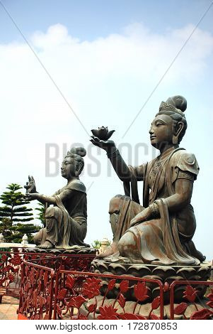 Statue Puja Bodhisattva at foot of Tian Tan giant Buddha Po Lin Monastery Ngong Ping Lantau Island Hong Kong China