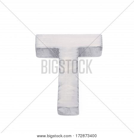 Single sawn wooden letter T symbol coated with paint isolated over the white background