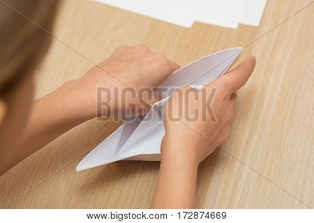 Girl Makes A Sheet Of Paper Boat