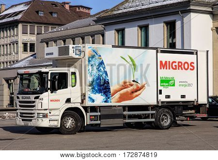 Zurich Switzerland - 27 January 2017: a Scania truck of Migros parked on Rathausbrucke bridge. Migros is Switzerland's largest retail company its largest supermarket chain and largest employer.