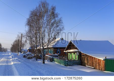 VISIM/ RUSSIA - JANUARY 8. Snow-covered russian old believer village in frosty sunny winter day on January 8, 2015 in village Visim, Ural region, Russia.