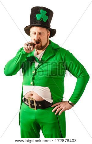 Photo of a man in a Leprechaun costume smoking a cigar.