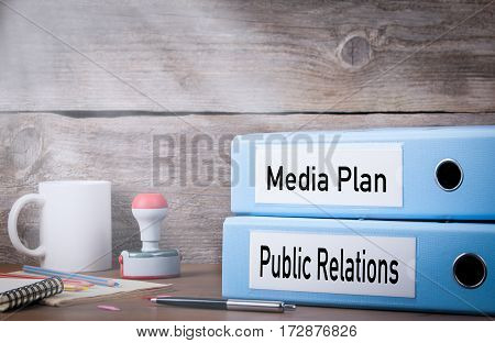 Public Relations and Media Plan. Two binders on desk in the office. Business background.