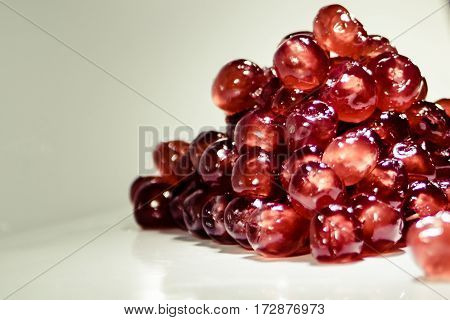 Glazed cherries with white back ground in a pile