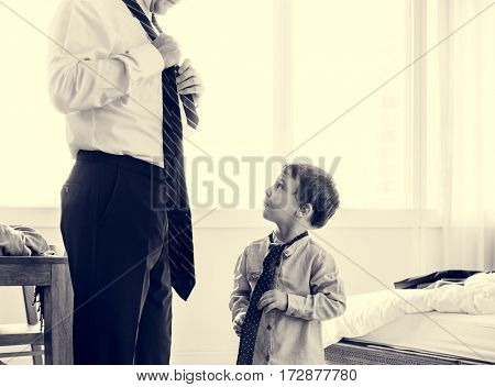Father teaching the son how to tie like a gentleman