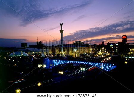 Maidan Nezalezhnosti square top view at evening time. Nezalezhnosti monument against beautiful sunset.