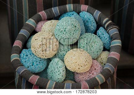 Multicolored pumice in striped sack. Arab souvenirs.