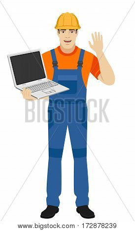 Builder with laptop greeting someone with his hand raised up. Full length portrait of builder in a flat style. Vector illustration.