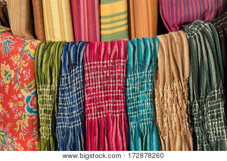 Multicoloured different kinds of scarves. Sale.May be as textile background.
