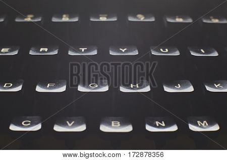 Detail of a black vintage typewriter close up on keys.