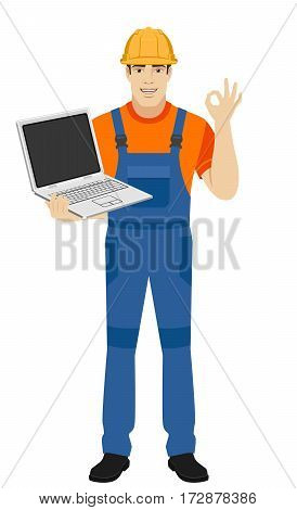 Builder with laptop show a okay hand sign. Full length portrait of builder in a flat style. Vector illustration.