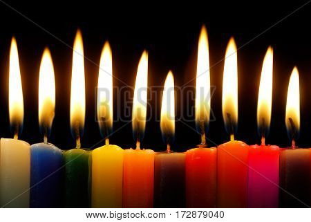 Set of candles in the dark concept of religion