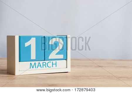 March 12th. Image of march 12 wooden color calendar on white background. Spring day, empty space for text.
