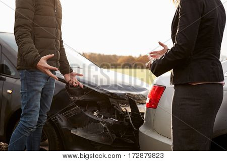 Two Drivers Arguing Over Damage To Cars After Accident