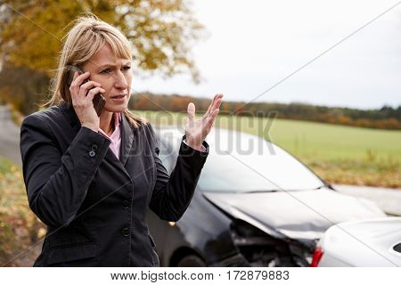 Woman Calling To Report Car Accident On Country Road