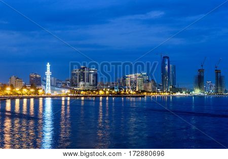 Baku Azerbaijan - September 10 2016: Night view of seaside of Baku from Seaside boulevard. Baku is the largest city on the Caspian Sea and of the Caucasus region