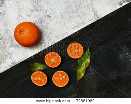 The group of fresh mandarins on a wooden board