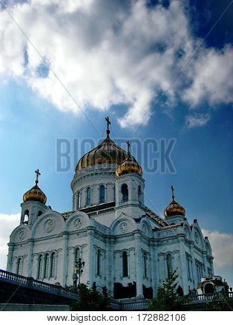 Golden domes of the Cathedral of Christ the Savior against the blue sky. Summer, Moscow, Russia