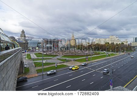 MOSCOW RUSSIA - OCTOBER 15 2016: View of Square of Europe and Kiyevsky railway terminal from a pedestrian bridge across the Moscow River. October cloudy.