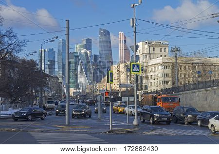 MOSCOW RUSSIA - JANUARY 21 2017: View from Borodinsky bridge along the Bolshaya Dorogomilovskaya street toward the skyscrapers of the international business center Moscow-City. A combination of different architectural styles. Moscow January sunny day.