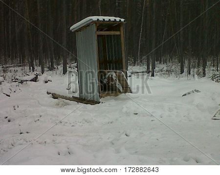 Siberian outhouse - toilet - restroom during winter at an oilfield