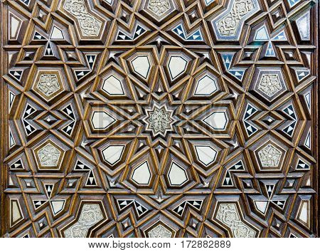 Closeup of arabesque ornaments of an old an aged decorated wooden door Old Cairo Egypt