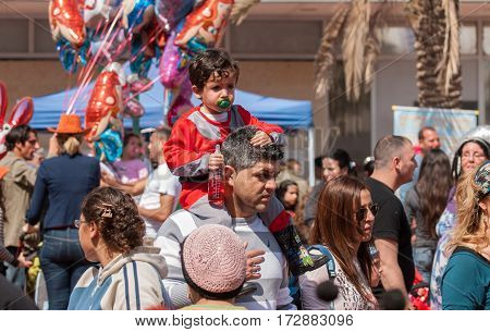 Happy Jewish Family - Father And Child, Celebrate The Purim Holiday At Street Event