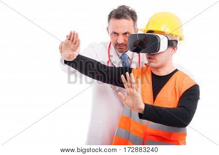 Medic Helping Constructor Holding Hands With Virtual Reality Glasses