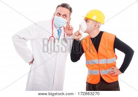 Doctor Making Listening Gesture And Constructor Showing Sush
