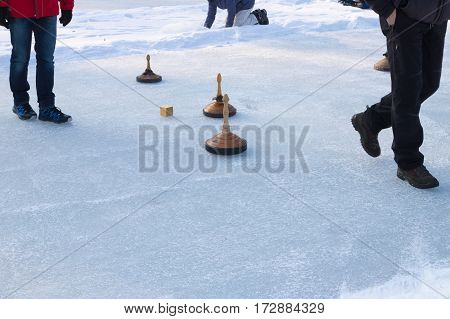 People Playing Curling On A Frozen Lake, Austria, Europe