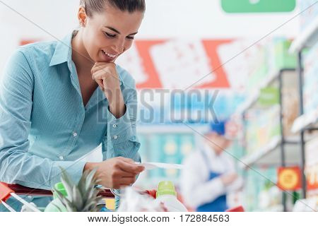 Woman Checking A Shopping List