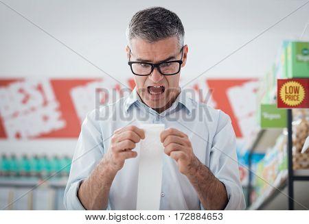 Man Checking A Long Receipt
