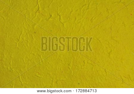 Handmade recycled yellow paper for texture and background.