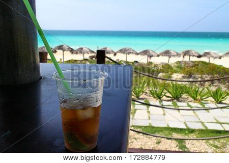 Cuban Rum on bar with a beach background