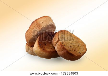 Slices of garlic bread on abstract background