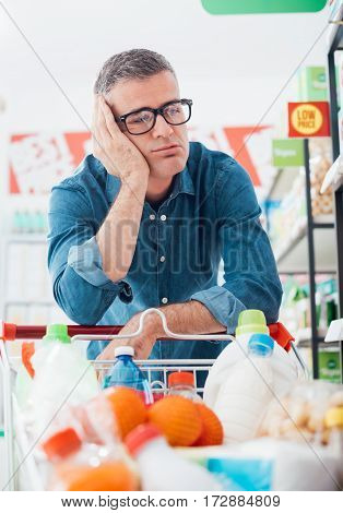 Sad Man Shopping At The Supermarket