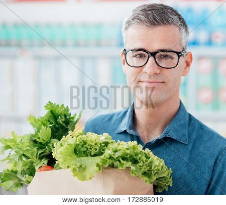 Man Buying Vegetables At The Store