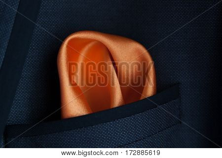 close up of a orange handkerchief in a pocket