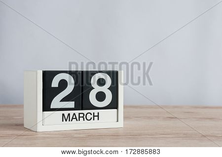 March 28th. Image of march 28 wooden color calendar on white background. Spring day, empty space for text.
